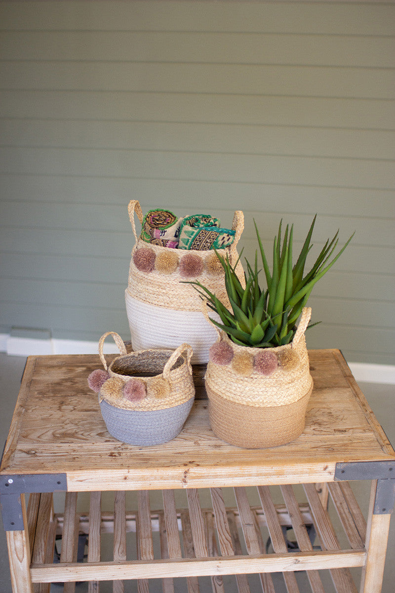 Seagrass and cotton folding baskets with pom poms