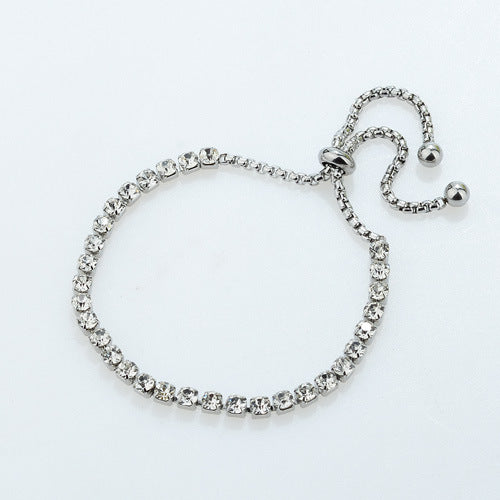 Rhodium Plated Tennis Style Bracelet with Clear Charming Stones