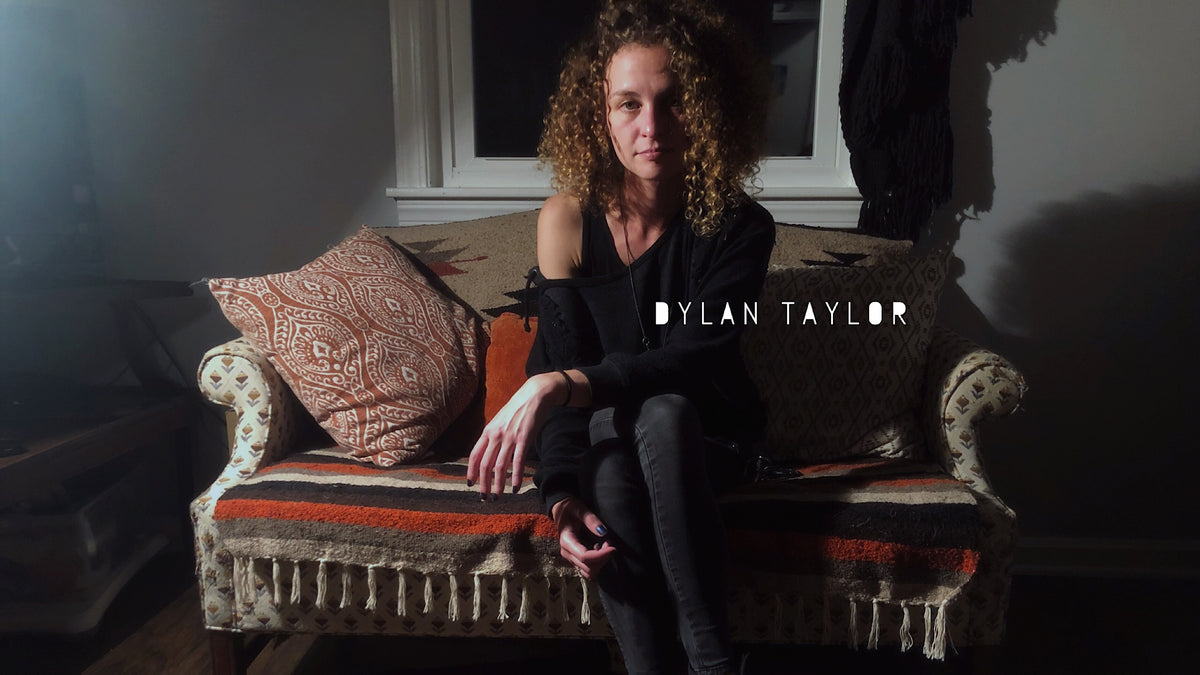 dylan taylor singer songwriter indie artist from music city nashville tn plays and writes country pop rock americana and folk with big curly hair and a dangerous streak of attitude