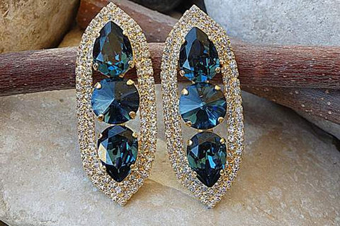 gold and dark blue earrings