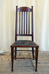 A High backed arts & crafts side chair in embroidered silk