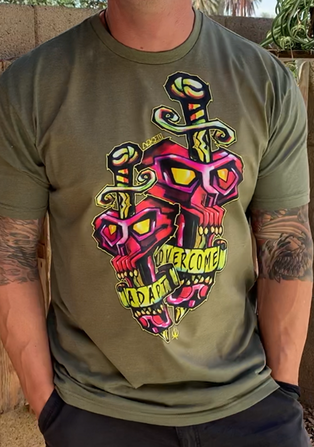 "Front- 2 Pink Skulls with Sword running through symbolizing the fight and the struggle yet each skull has a saying in it's mouth, ""Adapt"" and ""Overcome"" Back Arkeo1 Icon"