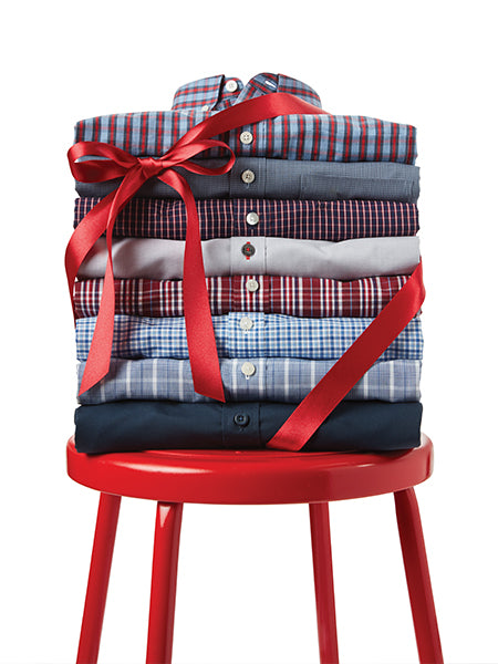 stack of shirts on a stool