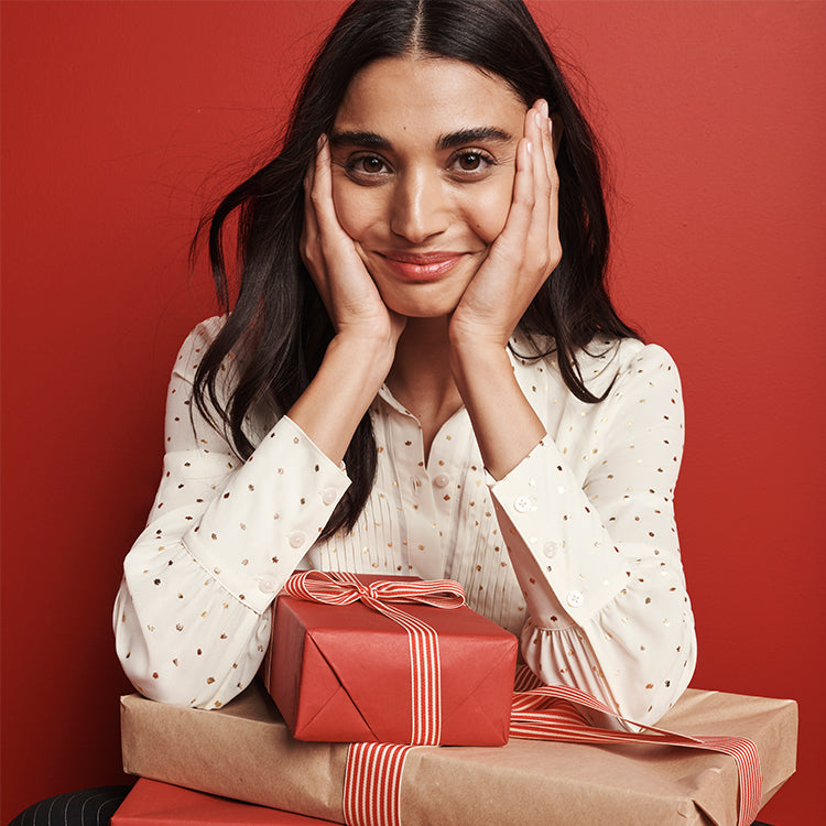 Woman sitting in front of presents