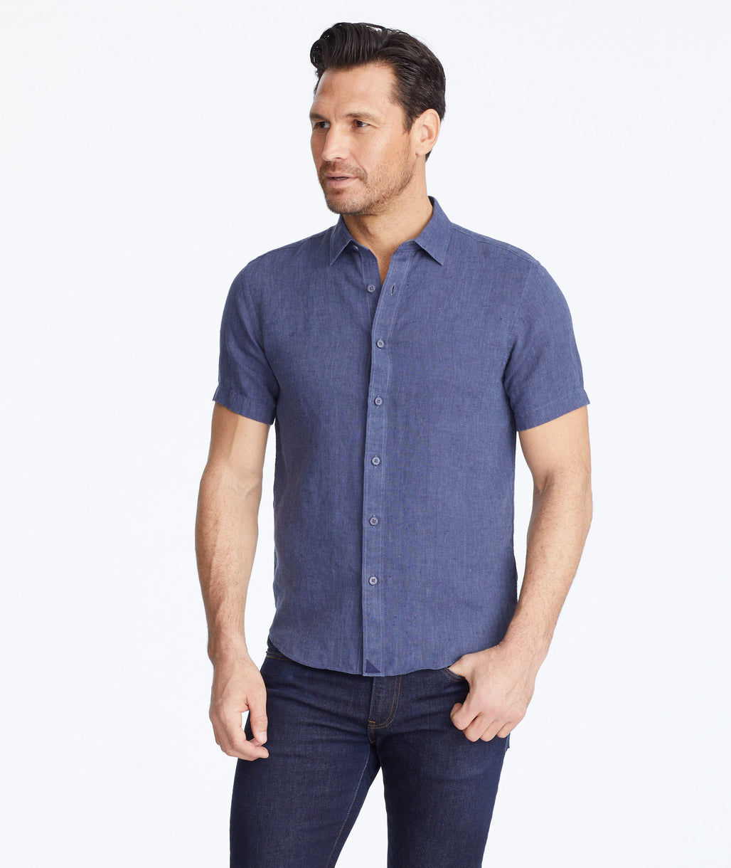 Model wearing a Navy Wrinkle-Resistant Linen Short-Sleeve Araujo Shirt