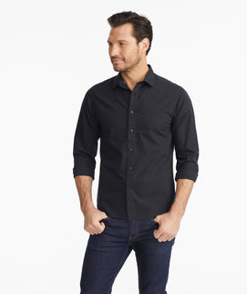 Model wearing a Solid Black Wrinkle-Free Black Stone Shirt
