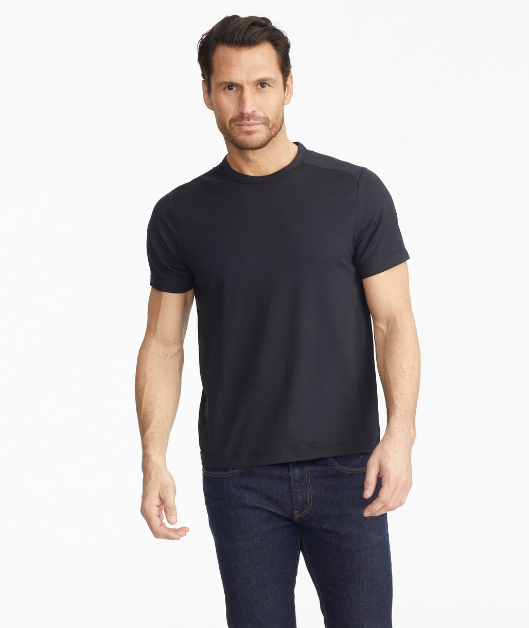 Model wearing a Black Performance Tee