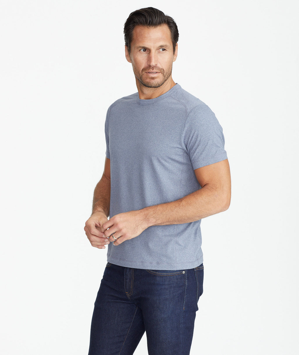 Model wearing a Blue Performance Tee