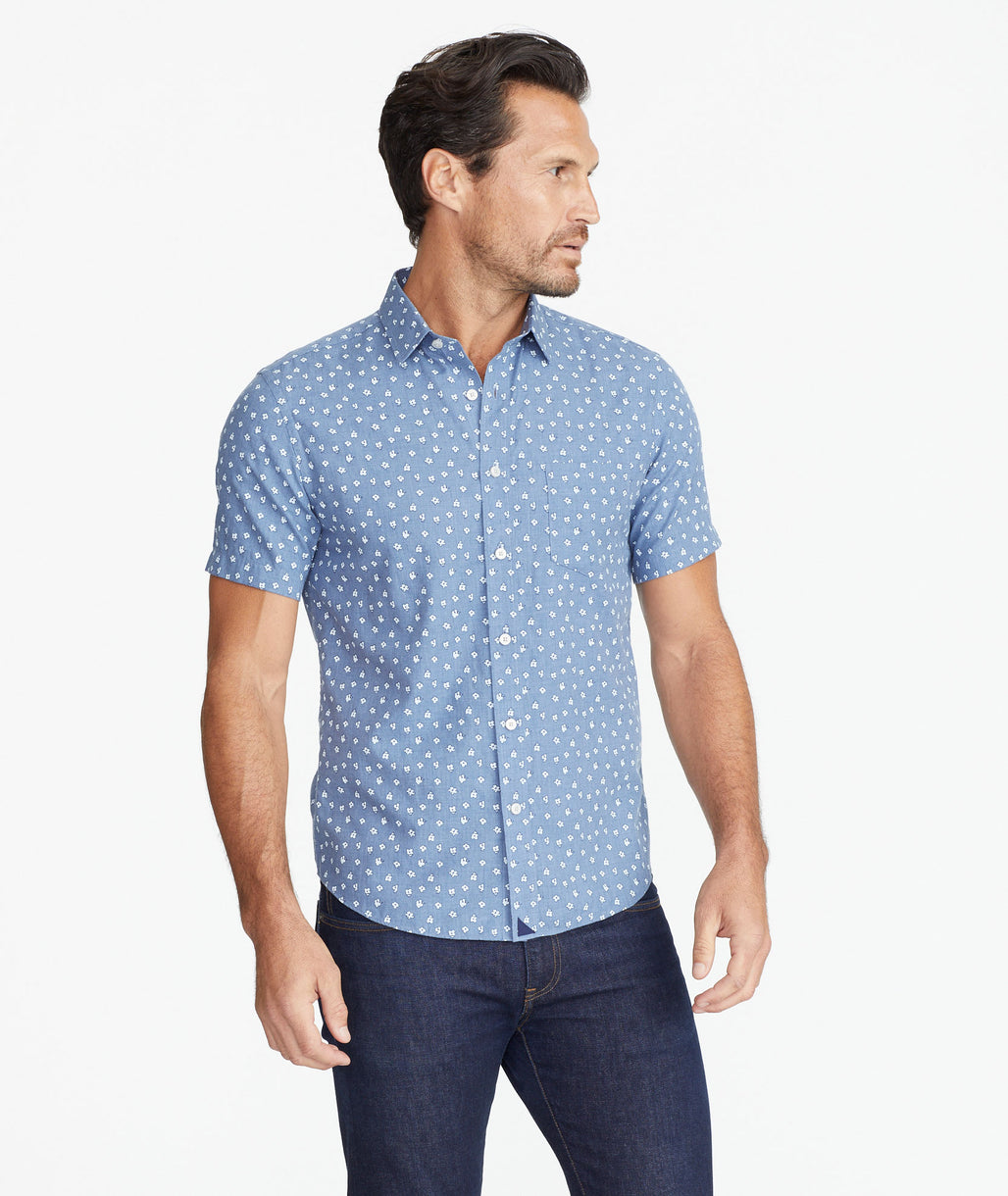 Model wearing a Blue Classic Short-Sleeve Shirt with Floral Print