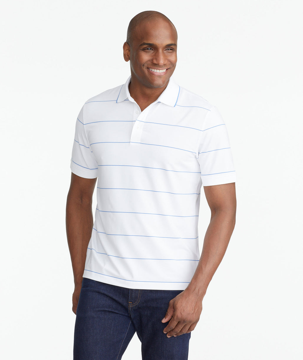 Model wearing a White Luxe Performance Polo