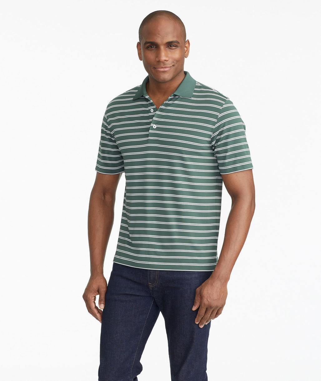Model wearing a Dark Green The Luxe Performance Polo - FINAL SALE