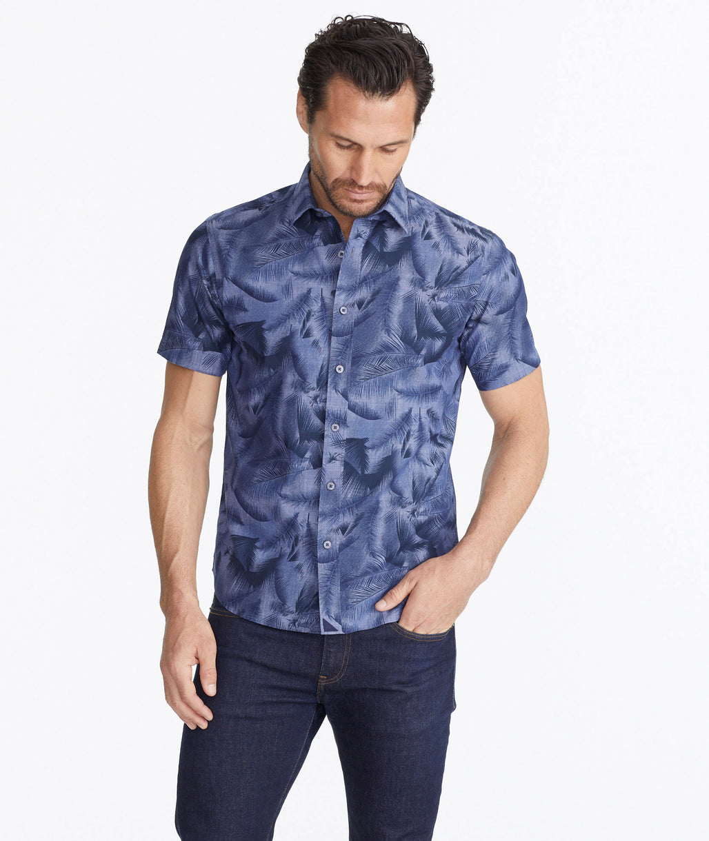 Model wearing a Navy Classic Short-Sleeve Shirt with Hawaiian Print