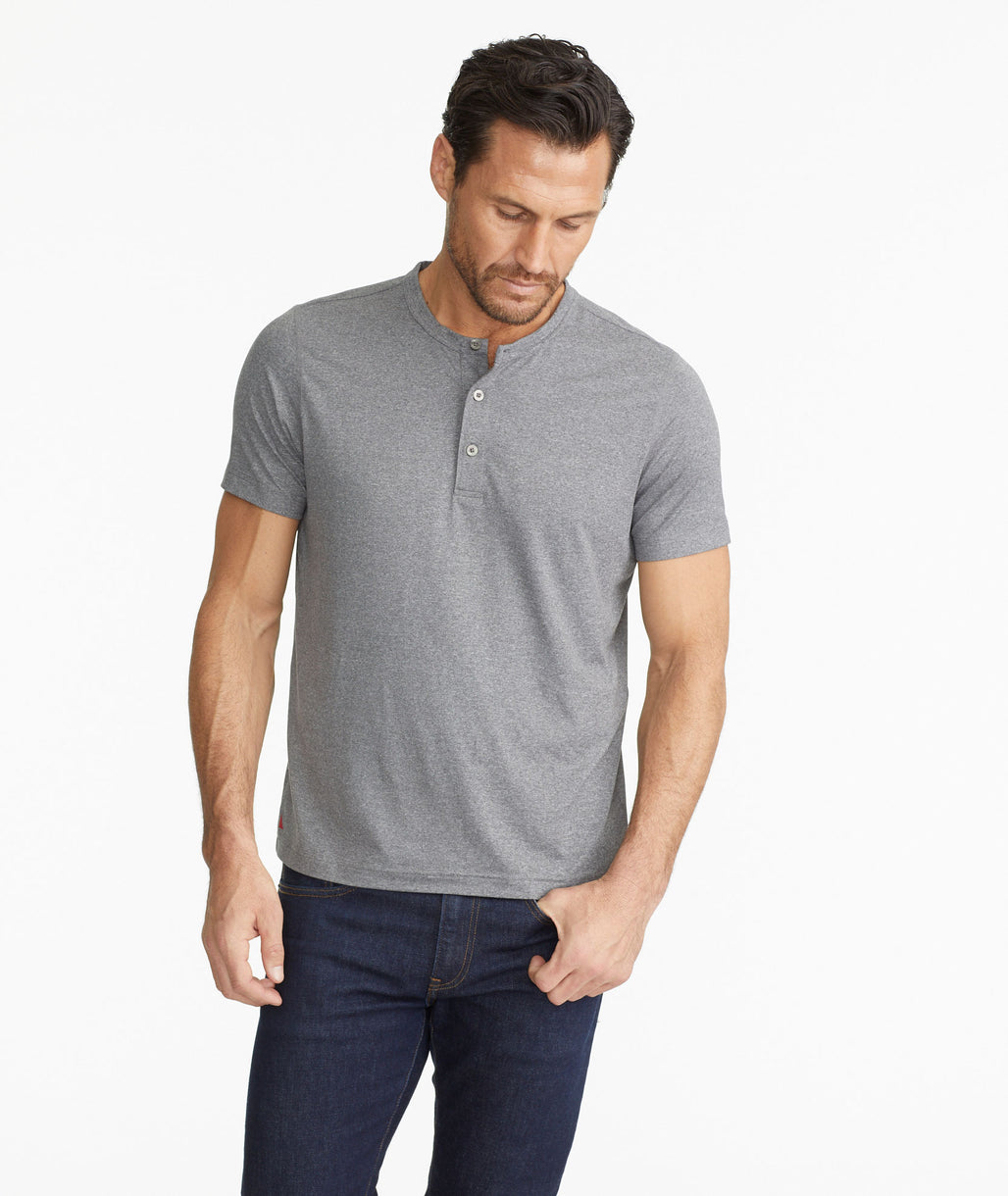 Model wearing a  Short-Sleeve Performance Henley