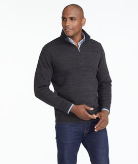 Model wearing a Black Fleece Quarter-Zip