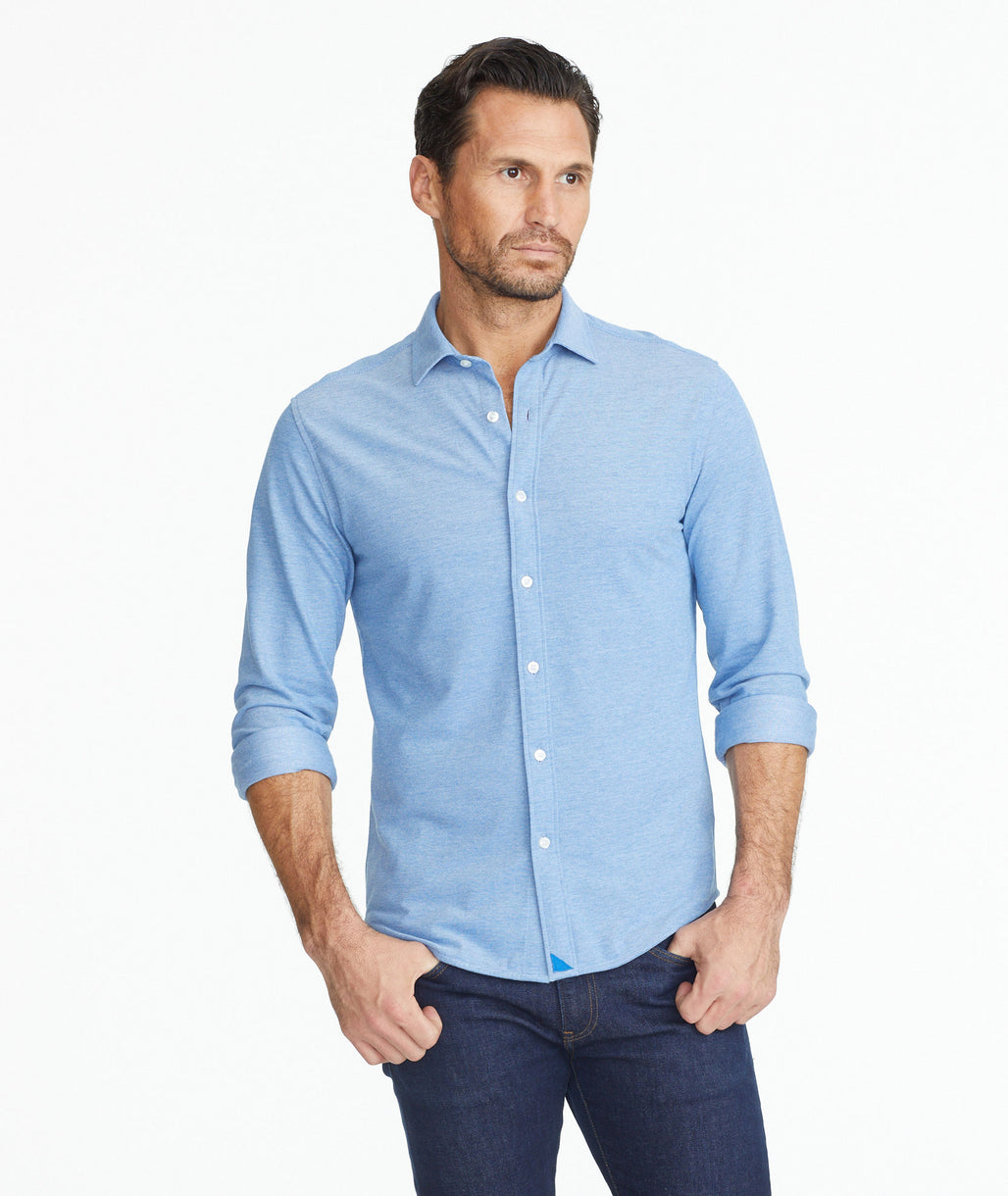 Model wearing a Sea Blue Pique Polo Hybrid Shirt