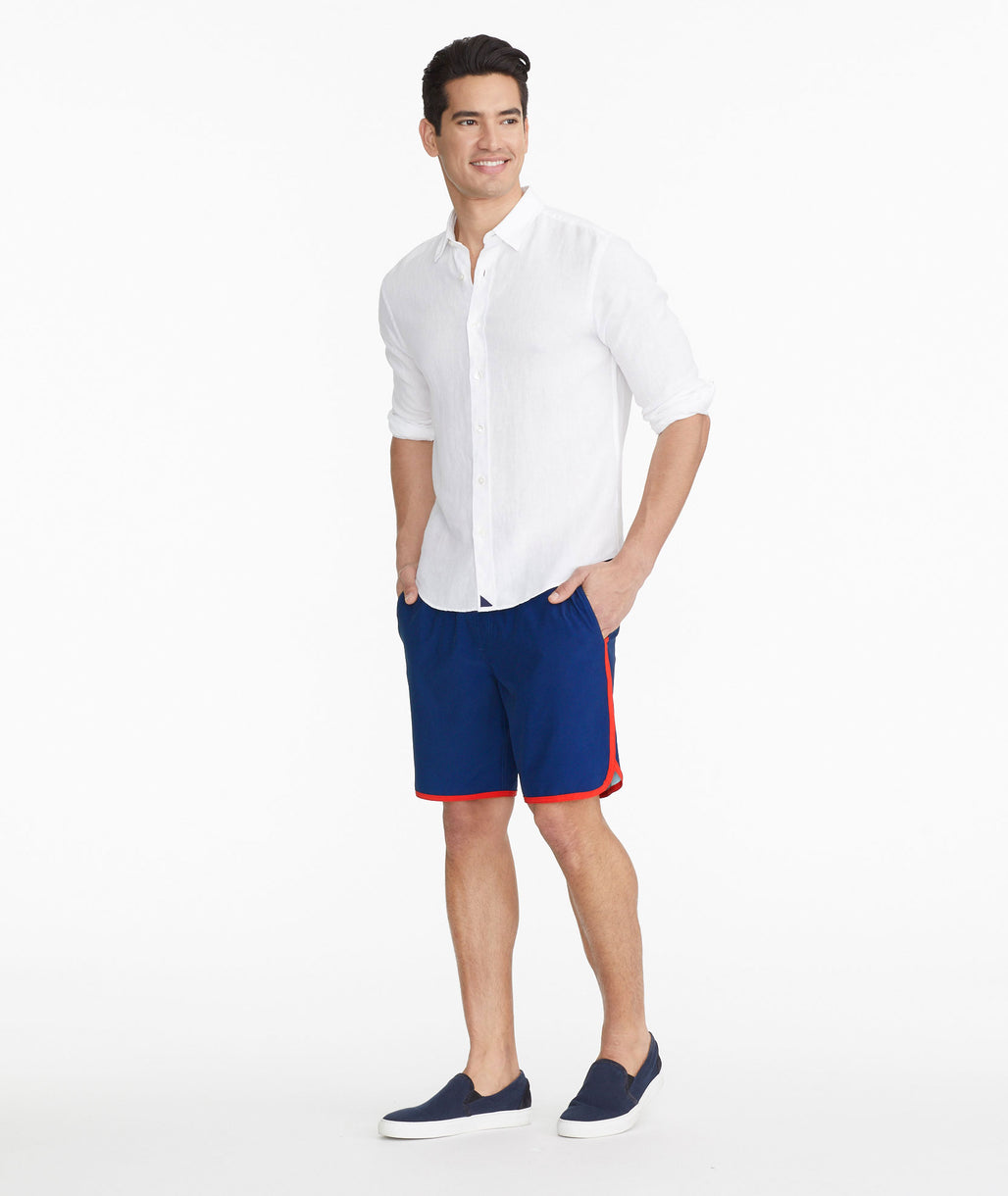 Model wearing a Navy The 8-Inch Recycled Swim Short - FINAL SALE
