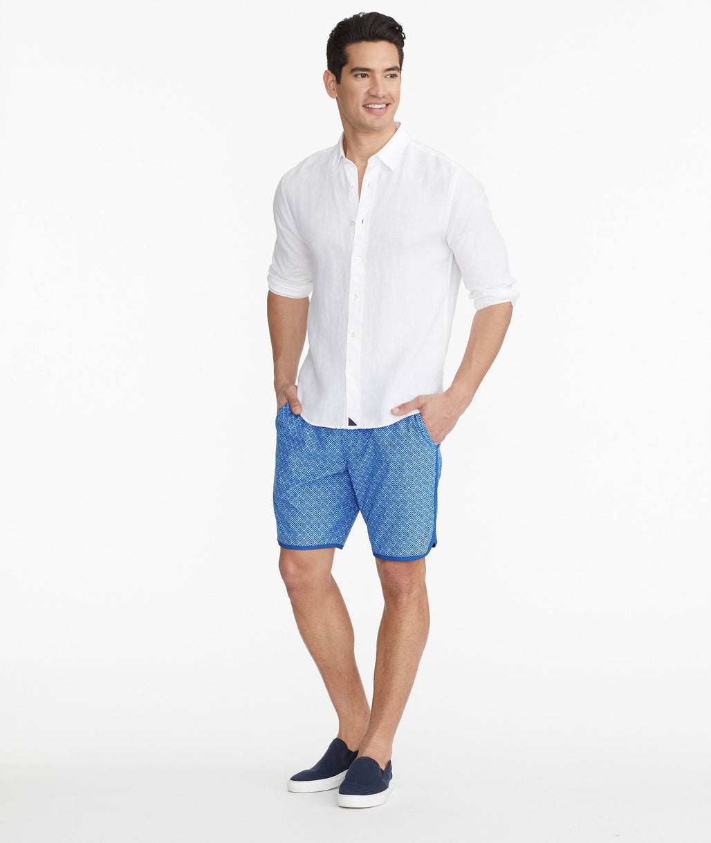 Model wearing a Blue The 8-Inch Recycled Swim Short - FINAL SALE
