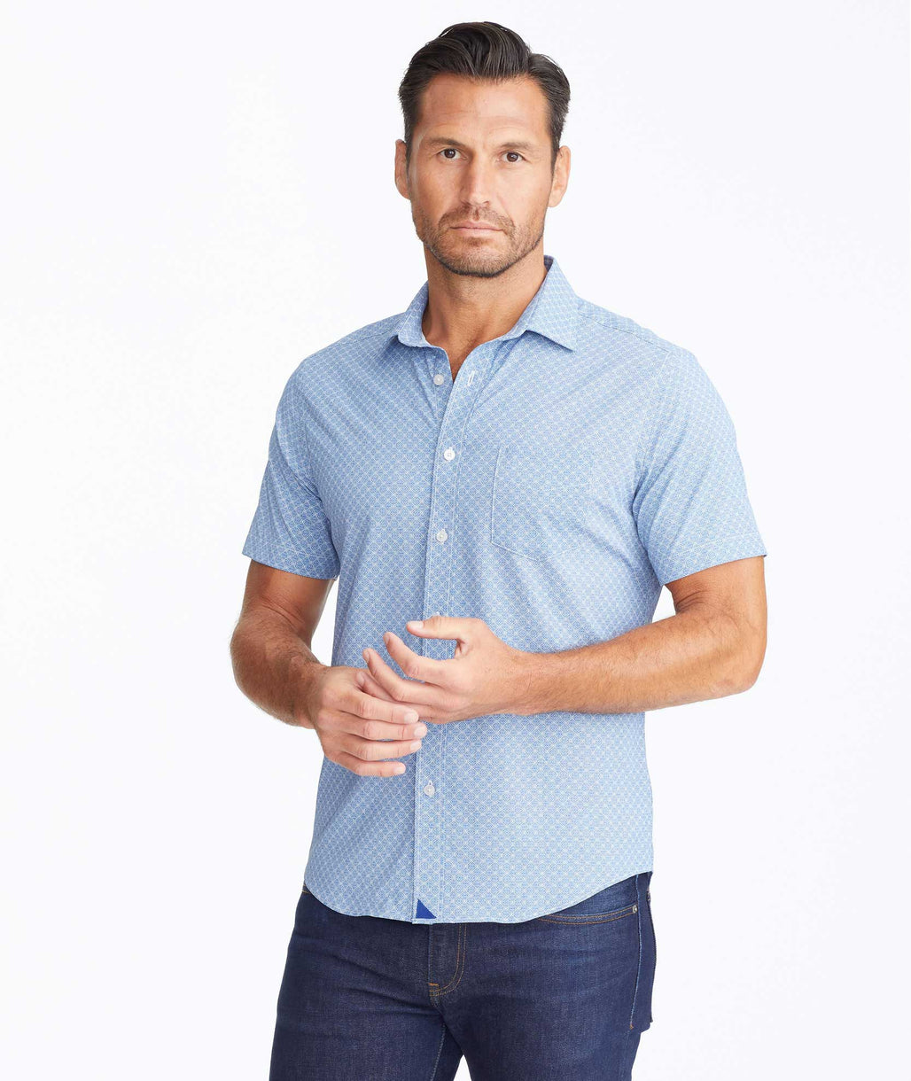 Model wearing a Navy Wrinkle-Free Performance Short-Sleeve Weibel Shirt