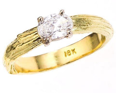 18k diamond ring - oval diamond with twig nature inspired band