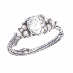 ENGAGEMENT RING INCORPORATING AN ANTIQUE DIAMOND AND CULTURED SEED PEARLS