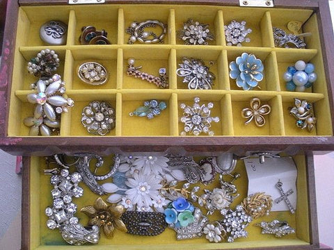Box of vintage brooches