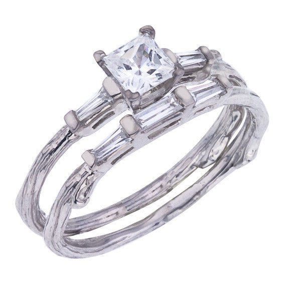 Princess cut diamond twig engagement ring shown with matching diamond band.