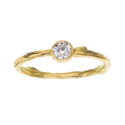 Fine twig engagement ring with bezel set round diamond. 18K recycled Yellow gold. BMJNYC