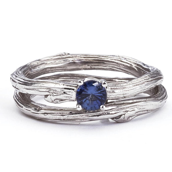 Blue sapphire solitaire engagement ring with matching twig wedding band.  18K recycled gold.