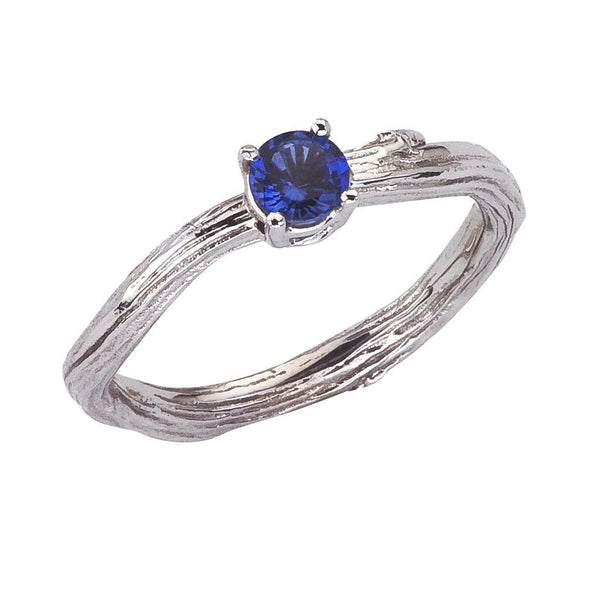 Blue sapphire twig engagement ring. White 18K recycled gold. Designed by Barbara Polinsky.