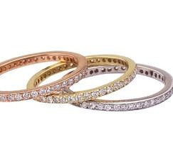 Thin diamond eternity bands in eco friendly 18K gold.