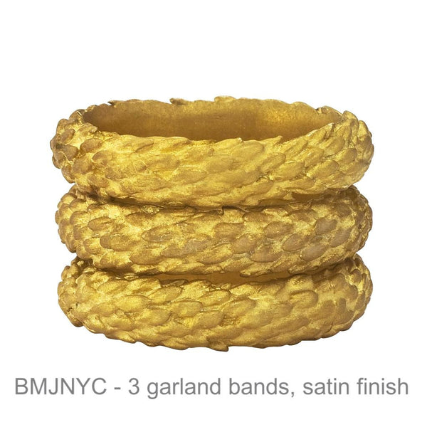 Garland bands stacked, natural twig details running in alternate directions.  18K recycled gold.