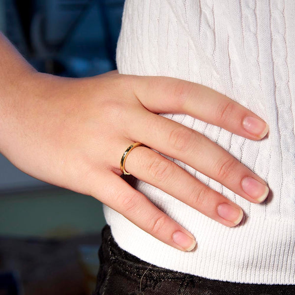 Simple hand forged 18K gold ring accented with a diamond.