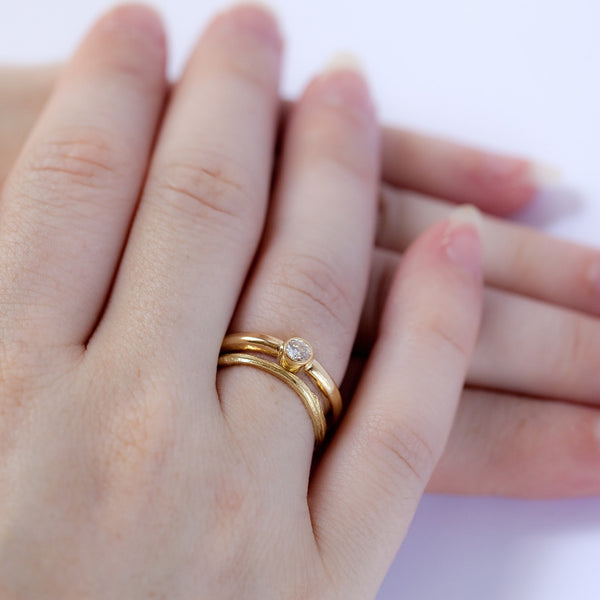 Bezel Solitaire with Twig Wedding Ring on Model, Yellow Gold and White Diamond, Polished Finish, Beautiful and Simple.