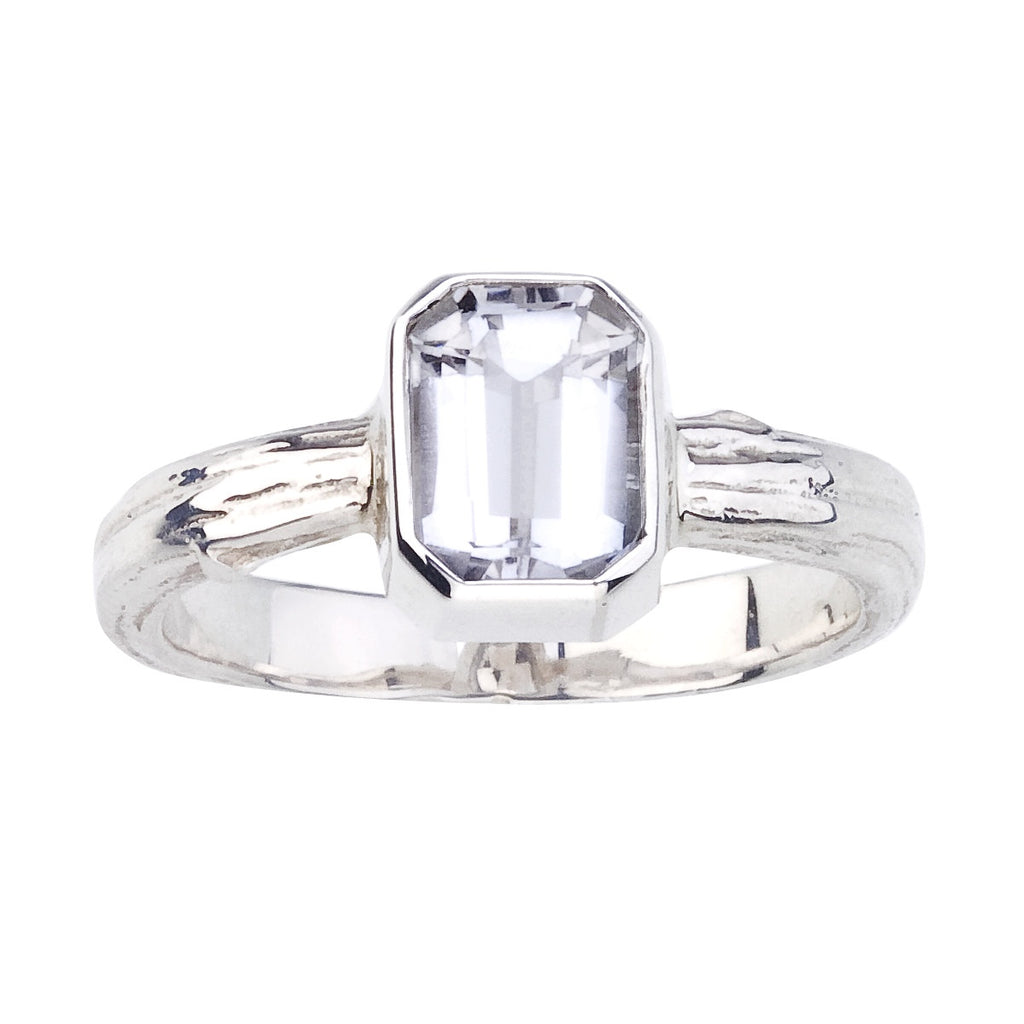 bezel set emerald cut solitaire ring with rustic details