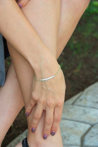 The model is wearing Barbara Polinsky's Peridot and Twig Bracelet.