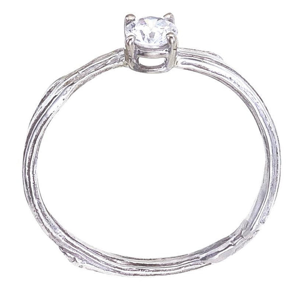 Delicate sprig engagement ring with small diamond in white gold - side view showing four prong basket setting.