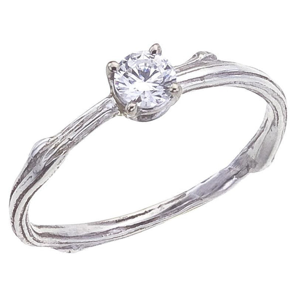 Narrow twig diamond engagement ring. Quarter carat, prong set in 18K recycled gold.  Simple and Elegant in White Gold.