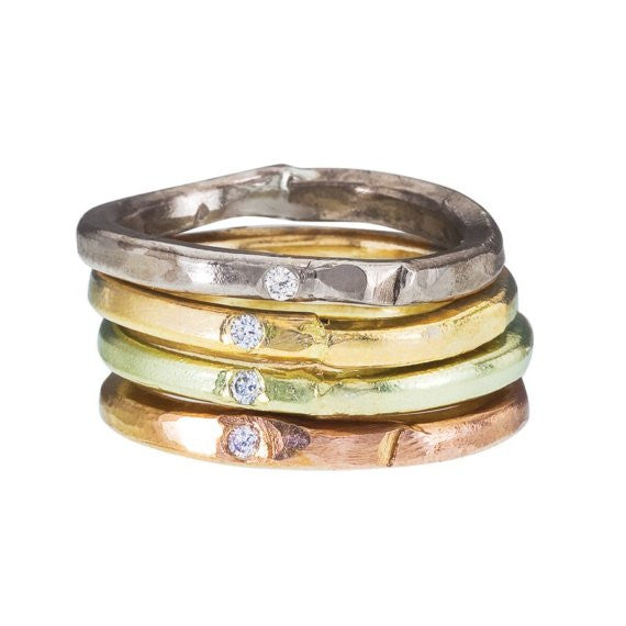 Simple handmade 18K gold band accented with a diamond. Intentionally perfectly imperfect!  Designed by Barbara Polinsky.