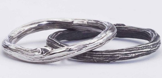 Shiny and oxidized sterling silver twig rings.
