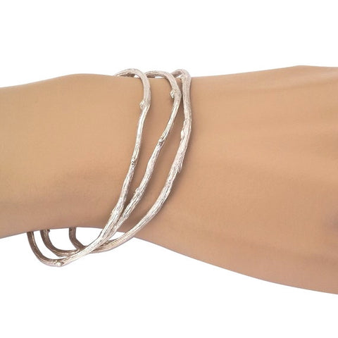 Three sterling silver Twig Bangle Bracelets bring the outdoors to your wrist.