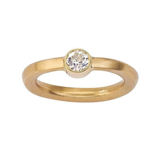 Canadian diamond solitaire engagement ring.  Simple and modern.  18K eco friendly gold.  Designed by Barbara Polinsky.
