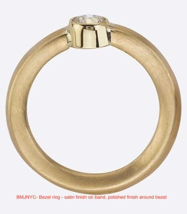 Side view of bezel set Canadian diamond engagement ring.  !8K recycled gold.