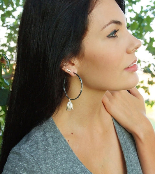 Model Wearing Oxidized Twig Hoop Earrings With Pod Dangle. Asymmetrical Earrings.  Handmade or Recycled Silver.
