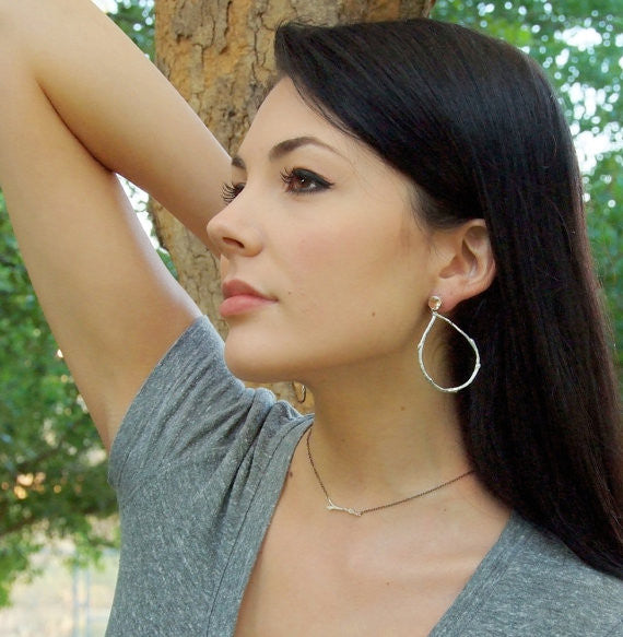 Model is wearing Barbara Polinsky's Sterling Silver Teardrop Earrings with Lemon Quartz accent.