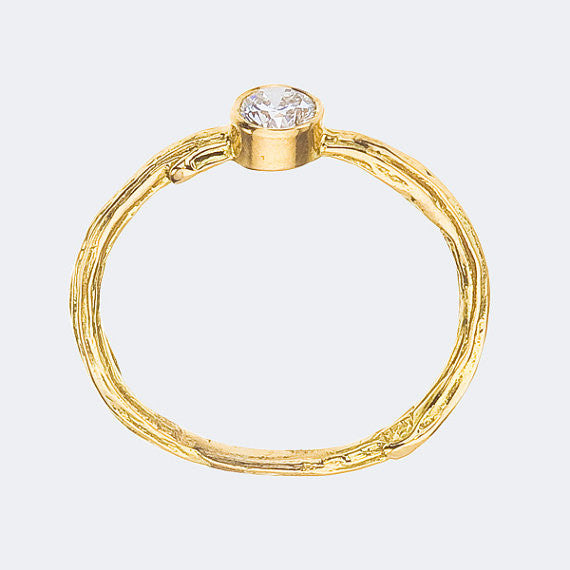 Nature inspired bezel diamond engagement ring. Sweet and Simple in recycled gold - side view in yellow gold.