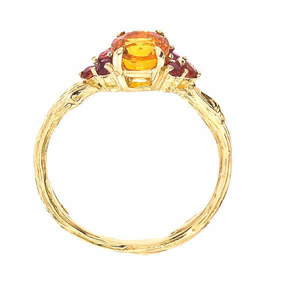 Side view of Sapphire Twig Ring with Orange and Red Sapphires set in 18K yellow recycled gold.