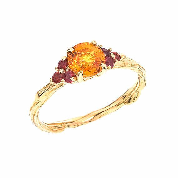 Orange and Red Sapphires for an autumnal burst of colors on a sparkling twig ring. Designed by Barbara Polinsky.
