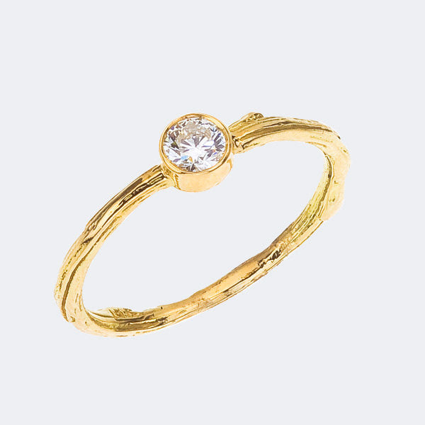 Bezel Ring with quarter carat diamond on narrow twig ring. Yellow, white or rose gold, handmade.