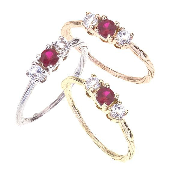 Ruby and white topaz three stone twig engagement ring shown in white, yellow and rose 18K recycled gold.