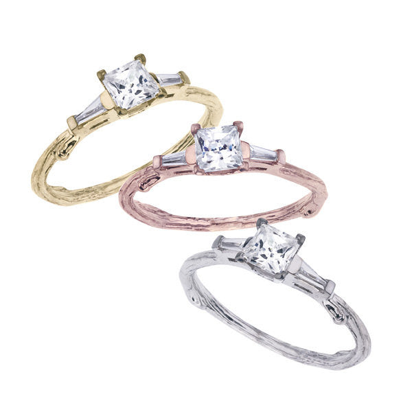 Princess cut diamond twig engagement ring with a tapered baguette on each side.  Shown in yellow, rose and white 18K recycled gold.